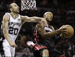 Miami's Ray Allen, right, tries to shoot against San Antonio's Manu Ginobili during the second half Sunday night in San Antonio. Ginobili had 24 points and 10 assists in a surprise start to spark the Spurs to a Game 5 victory.
