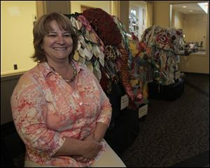 Jodi Russ, community librarian at the Bedford Public Library of the Monroe County Library System, says patrons love the elephant sculptures created by elementary students from across the county.