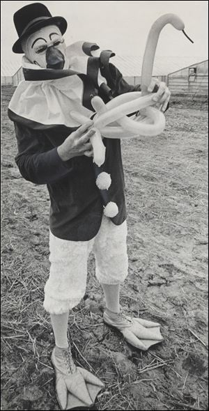 Eugene Curtis, as Quacky the Duck Clown, fashions a balloon sculpture in 1969 during a 50-year career.
