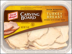 A package of Oscar Mayer Carving Board Turkey Breast shows natural-looking cuts.  Kraft Foods spent more than two years to develop the uneven cutting process.