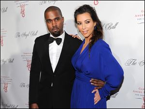 Kanye West and girlfriend Kim Kardashian attend a benefit in New York.