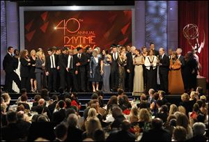 "The cast and crew of ""Days of Our Lives"" accept the award for outstanding drama series at the 40th Annual Daytime Emmy Awards on Sunday, in Beverly Hills, Calif."