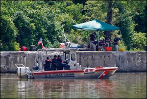 FBI personnel and a Coast Guard boat conduct another search in the Maumee River on Monday for Elaina Steinfurth, who has been missing for two weeks.
