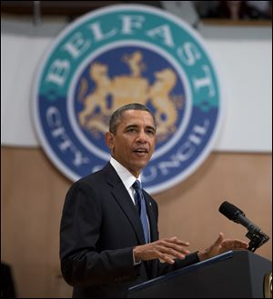 President Barack Obama gestures during a speech at the Belfast Waterfront Hall today in Belfast, Northern Ireland.
