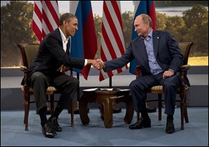 President Barack Obama and Russian President Vladimir Putin shake hands in Northern Ireland as they talk about their difference on Syria.