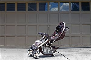 The damaged stroller at Sandra Vollmar's home serves as a reminder that the driver involved has not yet been caught.
