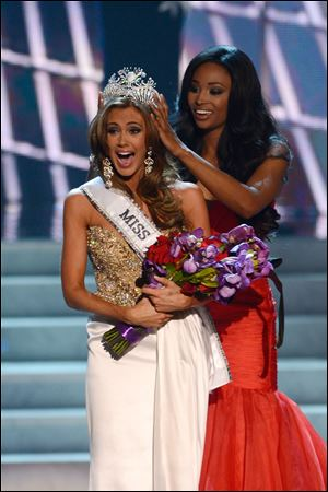 Miss Connecticut Erin Brady is crowned the winner of the Miss USA 2013 pageant by Nana Meriwether, Sunday, in Las Vegas.