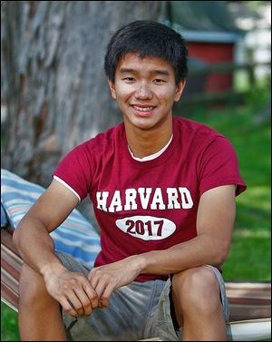 Springfield High graduate Dylan Tan, 18, wears a T-shirt given to him after being accepted into Harvard. His family moved to the United States from Malaysia.