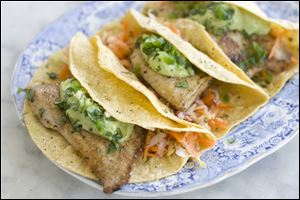 Healthy fish tacos with avocado.