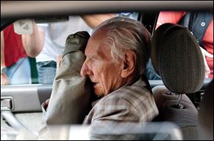 Alleged Hungarian war criminal Laszlo Csatary sits in a car as he leaves the Budapest Prosecutor's Office in July, 2012.