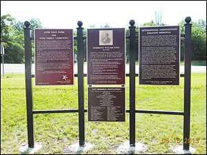Historical markers designate a former family farm, the Old King Farm in Delta, which was a station on the Underground Railroad. These markers were erected this week and sit in a parking lot overlooking the King family cemetery in Delta, Ohio