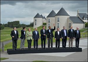 G-8 leaders from left, European Commission President Jose Manuel Barroso, Japan's Prime Minister Shinzo Abe, German Chancellor Angela Merkel, British Prime Minister David Cameron, U.S. President Obama, Russian President Vladimir Putin, French President Francois Hollande, Canadian Prime Minister Stephen Harper, Italian Prime Minister Enrico Letta and European Council President Herman Van Rompuy walk to a group photo opportunity during the G-8 summit at the Lough Erne golf resort in Enniskillen, Northern Ireland.