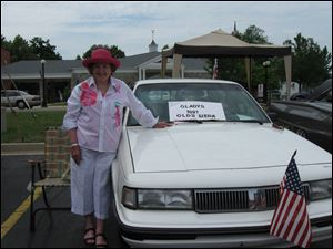 Mary Alice Powell with  Gladys, her 1991 Olds, at their first car show.
