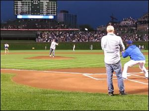 Mark Feldstein of  Sylvania, Ohio, throws out the first pitch at Wrigley Field on June 1 in Chicago.