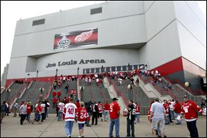 FILE - In this May 31, 2009, file photo, hockey fans enter Joe Louis Arena for Game 2 of the NHL Stanley Cup Finals hockey series in Detroit. The Detroit Red Wings and city official announced Wednesday, June 19, 2013, a $650 million plan for a new arena for the NHL team in the city's downtown entertainment and sports district. Red Wings and Tigers owner Mike Ilitch has long said that he wants a replacement for the 32-year-old Joe Louis Arena. (AP Photo/Carlos Osorio, File)