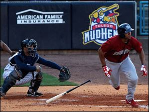 Lehigh Valley's Jermaine Mitchell hits a double against the Mud Hens.