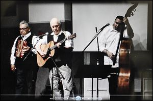 Accordian player Johnny Vassquez, guitarist Baldemar Velasquez, and bassist Ronaldo Revilla, Jr., are to perform at the Songs for Justice fund-raiser scheduled for Saturday at the Farm Labor Organizing Committee headquarters on Broadway.
