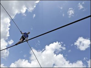 High wire performer Nik Wallenda walks across a wire as he practices Sarasota, Fla., Tuesday.