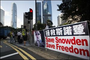 A banner supporting Edward Snowden, a former CIA employee who leaked top-secret documents about sweeping U.S. surveillance programs, is displayed at Central, Hong Kong's business district.