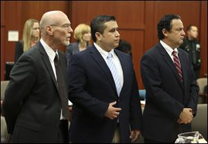 Attorney Don West, left, and jury consultant Robert Hirschhorn, right, stand with George Zimmerman as potential jurors enter the courtroom for Zimmerman's trial in Seminole circuit court in Sanford, Fla., Thursday.
