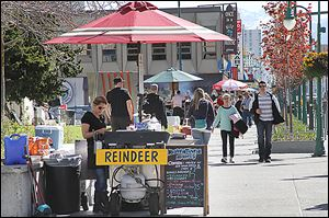 Reindeer dog vendors are set up in downtown Anchorage, a city that offers plenty of cultural, historical, and fun activities for cruise ship passengers who don't want to pay for expensive excursions.