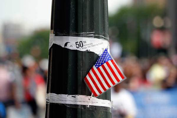 A-US-flag-on-a-pole-with-an-announ
