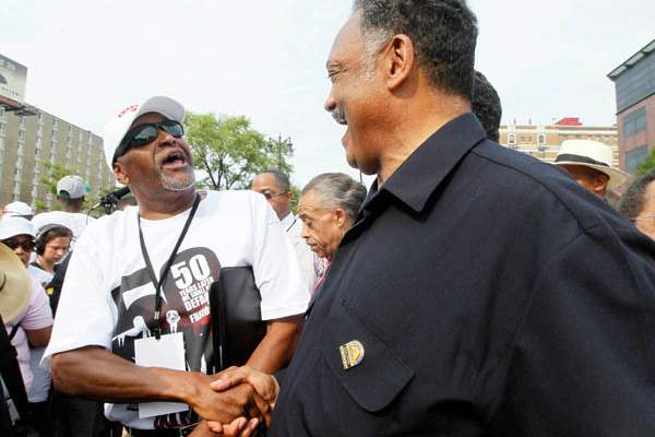 The-Rev-Jesse-Jackson-right-shakes-ha