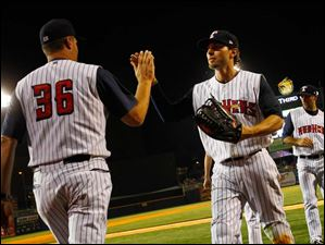 Toledo's Ben Guez high fives with his teammates after beating Pawtucket 8-5 Friday night.
