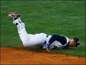 Toledo's Gustavo Nunez dives into the grass as he attempted to catch the ball.