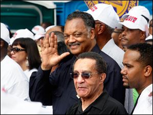 The Rev. Jesse Jackson waves to the crowd.