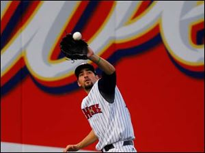 Mud Hens player Nick Castellanos catches a fly ball in the outfield.