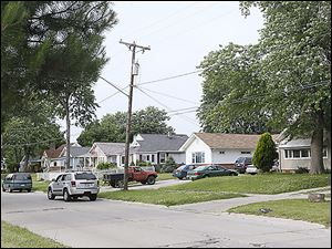 The city is attempting to purchase more than 20 homes along Collins Park Avenue in East Toledo to accommodate a water treatment plant upgrade. So far, only a handful of homeowners have sold.
