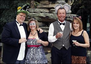 From left, Ian Hartten, Lisa Reichert, Mike Sager, and his wife Kris raise their glasses, dressed in festive animal-friendly wear at the Toledo Zoo's ZOOtoDo.