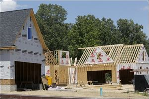 Construction is under way on three new houses in the Summerlyn complex in