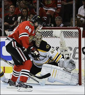 Chicago Blackhawks right wing Patrick Kane (88) scores against Boston Bruins goalie Tuukka Rask (40) in the second period during Game 5.