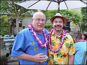 Jeff Ovenden, left, poses with luau co-host Jim Moore at his home to benefit the Young Artists at Work program