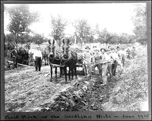 This 1915 photo provided by the Buffalo County Historical Society shows workers in Kearney, Neb., building the 'Seedling Mile' for the Lincoln Highway, to demonstrate the use of concrete as a roadway surface on what was formerly a dirt road.