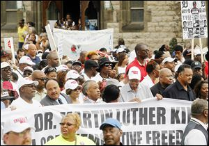 Noted dignitaries including  Martin Luther King, Jr.'s son, Martin Luther King III, second from left with mustache, the Rev. Al Sharpton, Detroit Mayor Dave Bing, in hat, and the Rev. Jesse Jackson participate in the United Auto Workers Detroit Freedom Walk.