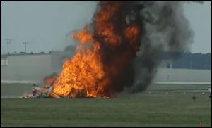 A stunt plane carrying a wing walker crashed then burst into flames at the Vectren Air Show near Dayton, Ohio.