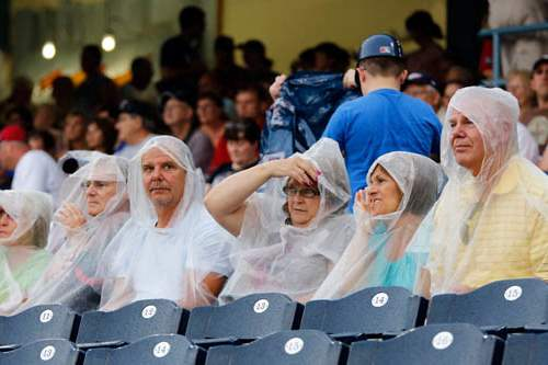 Fans-try-to-stay-dry-as-the
