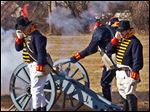 Re-enactors open fire during a celebration at the River Raisin National Battlefield Park.