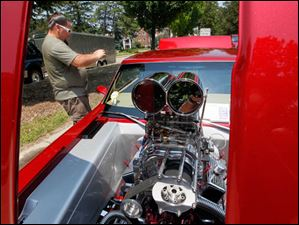 Brian Hairabedian of Toledo takes an interior picture of a 1967 Chevy II Nova (reproduction).