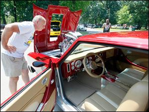 Dennis Moses of Toledo takes a look at the engine of a 1967 Chevy II Nova (reproduction).
