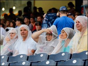 Fans try to stay dry as the Toledo Mud Hens take on the  Pawtucket red Sox.
