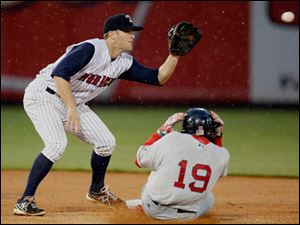 Toledo Mud Hens short stop Danny Worth makes play against Pawtucket's Jackie Bradley Jr. during the third inning.