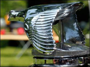 The silver quail on the front of a 1930 Model