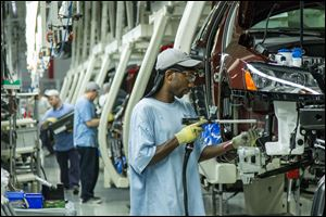 Workers assemble Volkswagen Passat sedans at the German automaker's plant in Chattanooga,