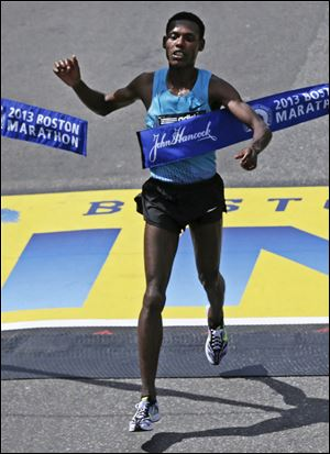 Lelisa Desisa, of Ethiopia, breaks the finish line tape to win the 2013 running of the Boston Marathon in April.