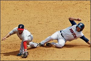 The Hens' Kevin Russo slides into second base safely while Jonathan Diaz was late in making the tag.