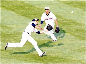 Toledo's Ben Guez runs in to makes a catch while teammate Danny Dorn backs him up in Sunday's game against Pawtucket.